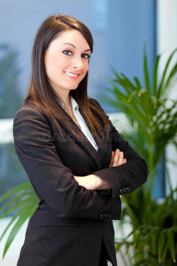 Smiling young female manager portrait royalty free stock photography