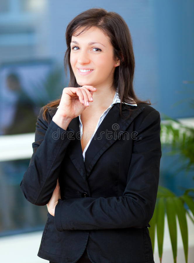 Smiling young female manager portrait stock image