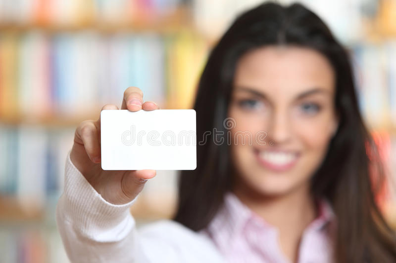 Smiling young female showing a business card stock photos