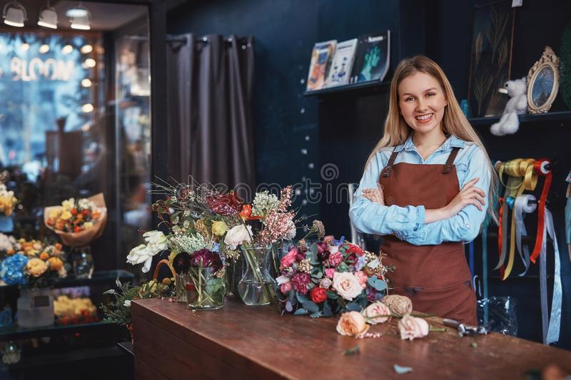 Smiling young florist in an apron stock photo