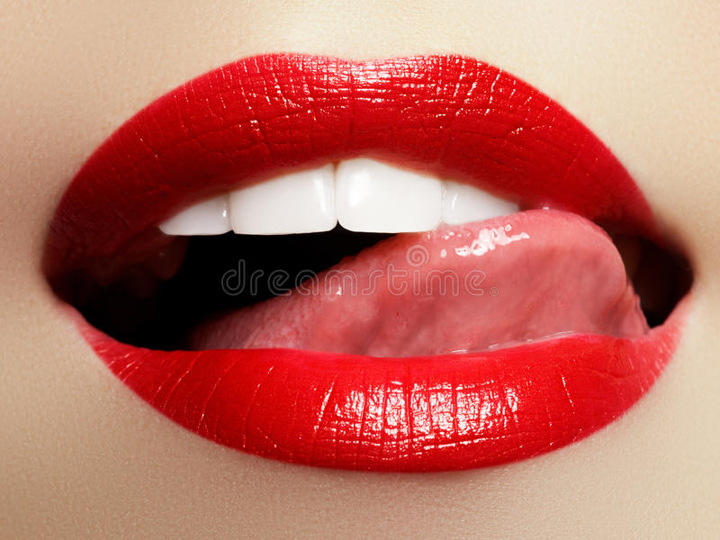 Smiling young girl. Beauty face closeup. lips. Beauty red lip makeup detail royalty free stock photo