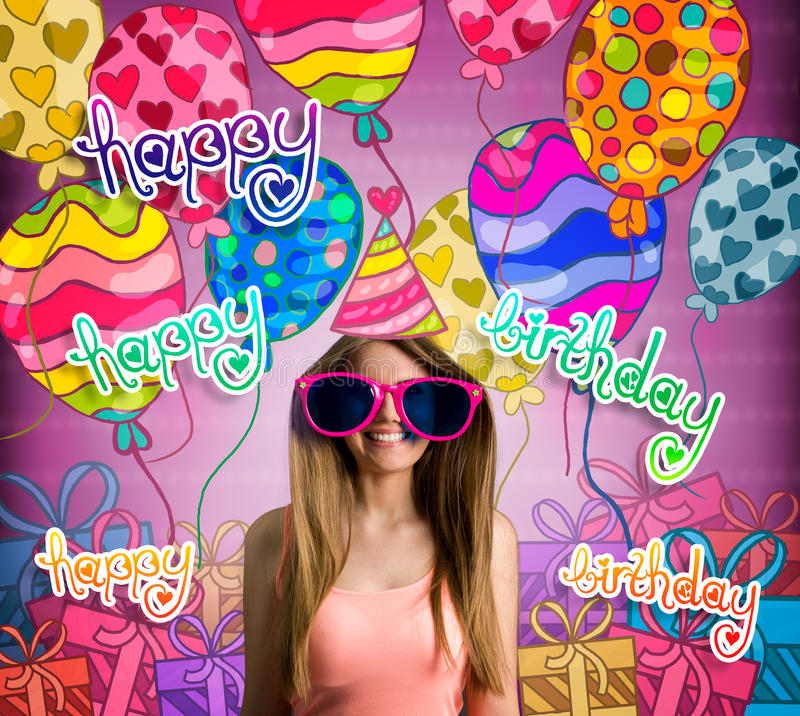 Smiling young girl in birthday hat royalty free stock photography