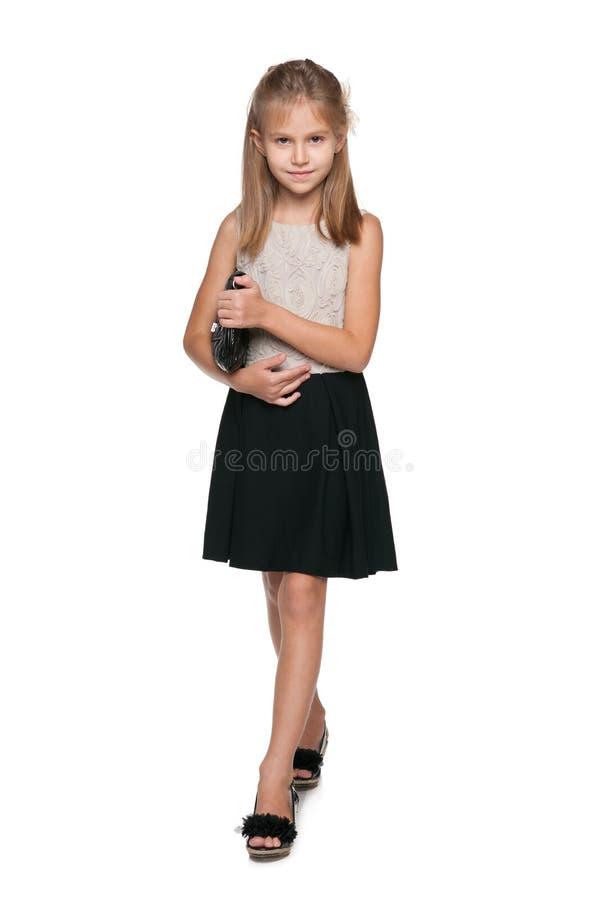 Smiling young girl with a handbag royalty free stock photos