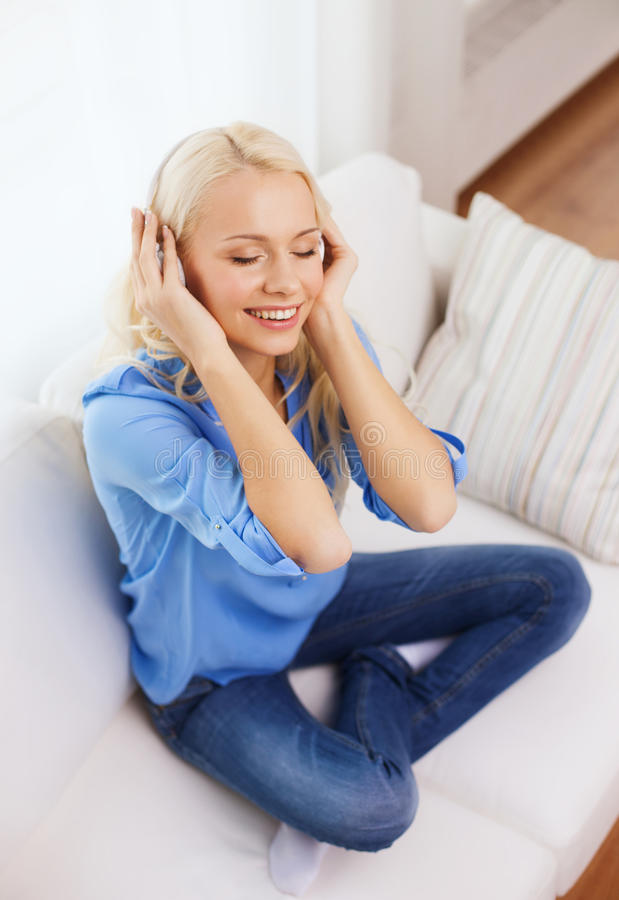 Download Smiling Young Girl In Headphones At Home Stock Photo - Image: 40042267