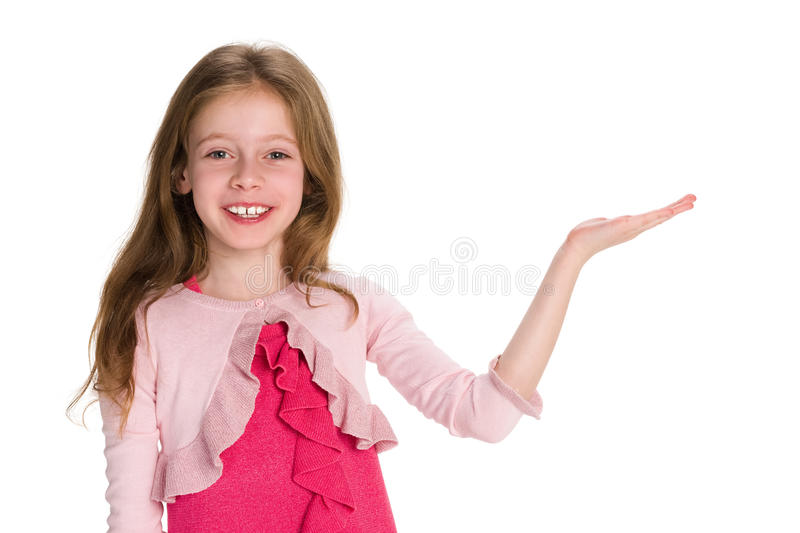 Smiling young girl makes a hand gesture royalty free stock photography