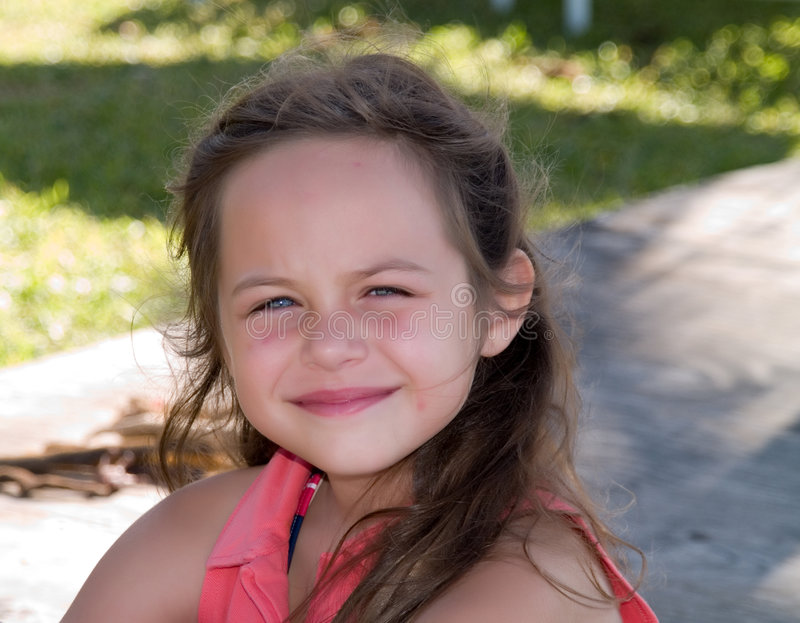 Smiling young girl outdoors stock photo
