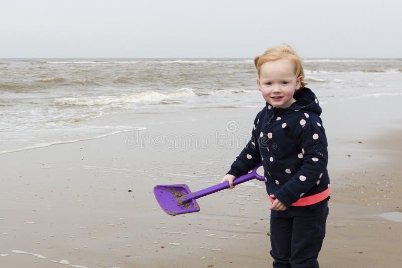 Smiling Young Girl Playing At North Sea Coast royalty free stock photos