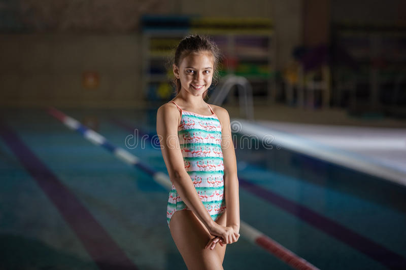 Smiling young girl in swimming pool royalty free stock photo