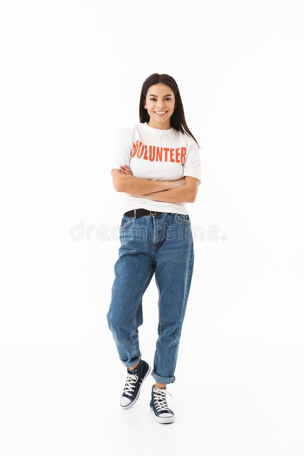 Smiling young girl wearing volunteer t-shirt standing stock images