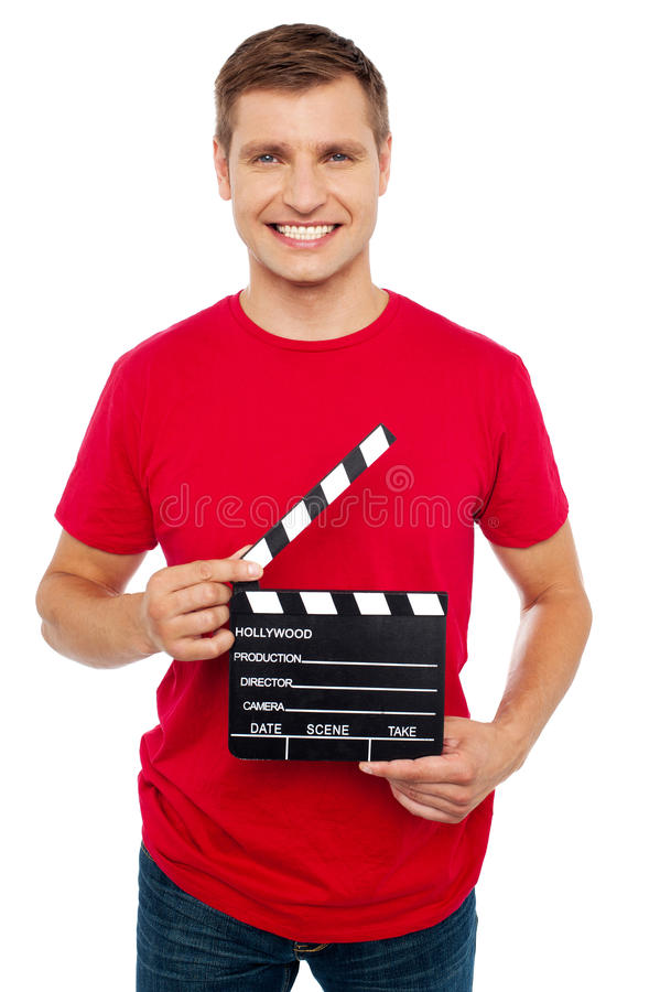 Download Smiling Young Guy Holding Clapperboard Royalty Free Stock Images - Image: 26395489