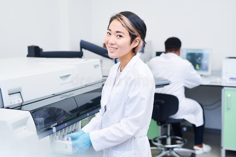 Smiling young laboratory worker royalty free stock photo