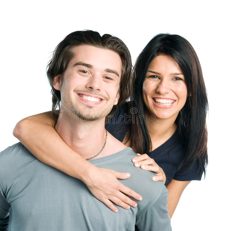 Smiling young latin couple piggyback royalty free stock image