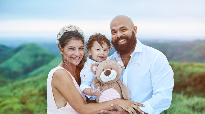 Smiling young latino family royalty free stock photo