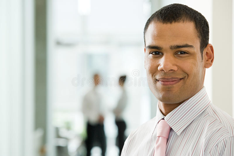 Smiling young male office worker royalty free stock photography