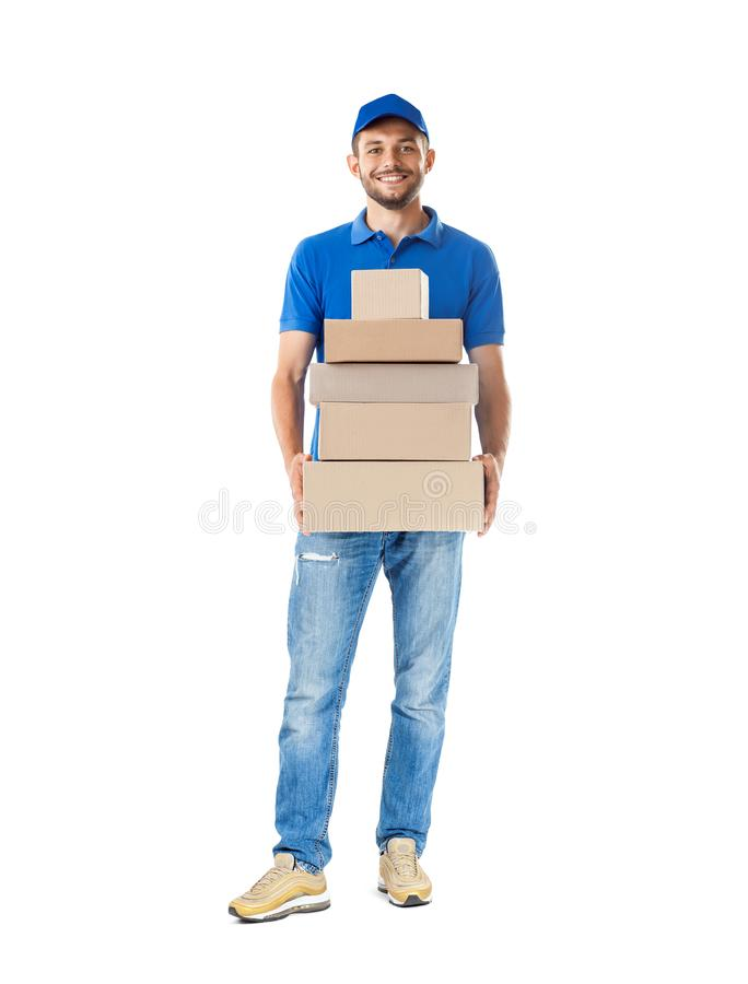 Smiling young male postal delivery courier man with delivering p royalty free stock photo