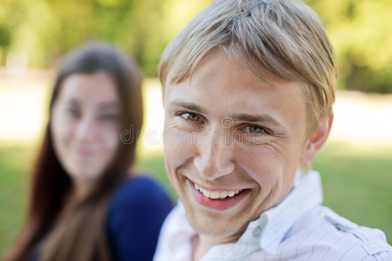 Smiling young man. Happy young women and men smiling together royalty free stock photos