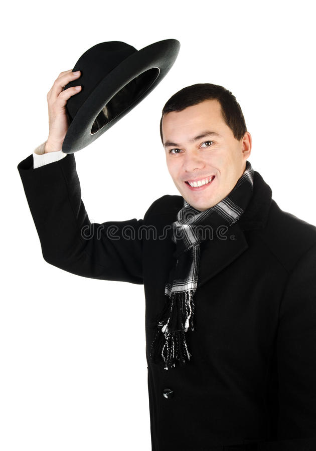 Download Smiling Young Man In Black Coat And Scarf Holding The Hat Isolat Stock Photos - Image: 28266823