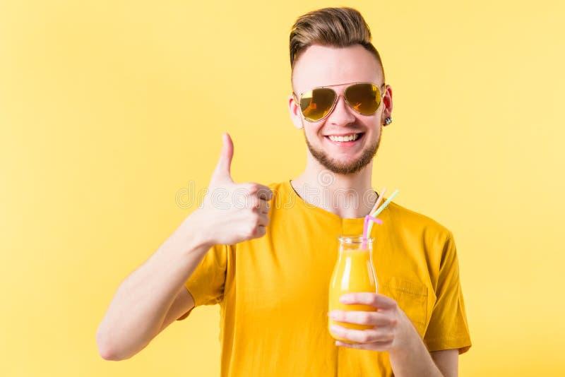 Smiling man bottle smoothie healthy fruit beverage stock images