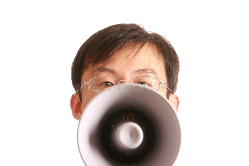 Smiling young man and bullhorn. One smiling young man isolated on white background stock photo