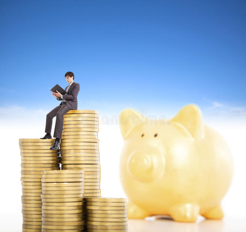 Download Smiling Young Man Counting Coin In Piggy Bank Stock Image - Image of concept, accounting: 36726093