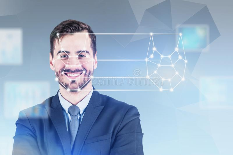 Smiling young man facial recognition technology stock image
