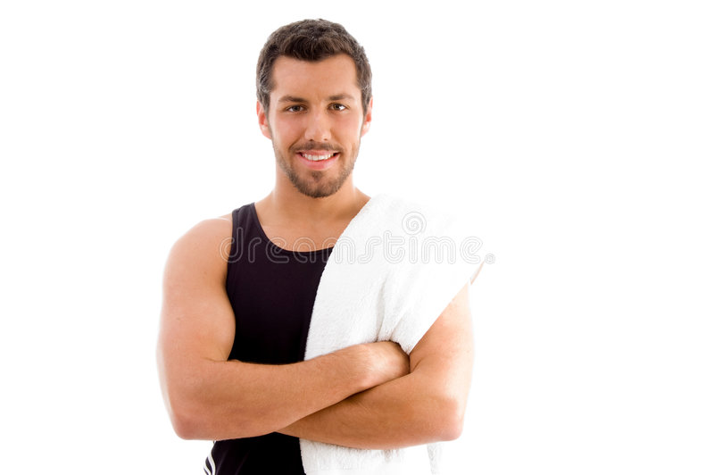 Smiling young man with folded arms. On an isolated background stock photos