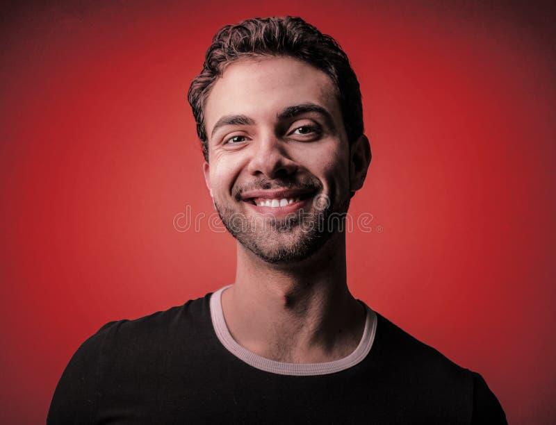 Smiling young man stock photos