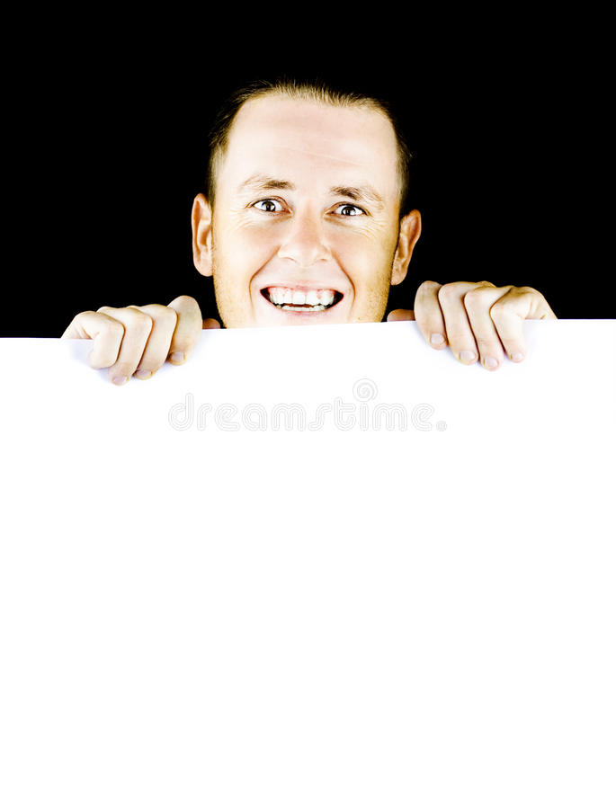 Download Smiling Young Man Holding Blank Poster Stock Photo - Image: 24722148