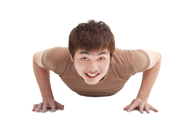 Smiling Young man makes push-up. Smiling Young man make push-ups and fitness stock image
