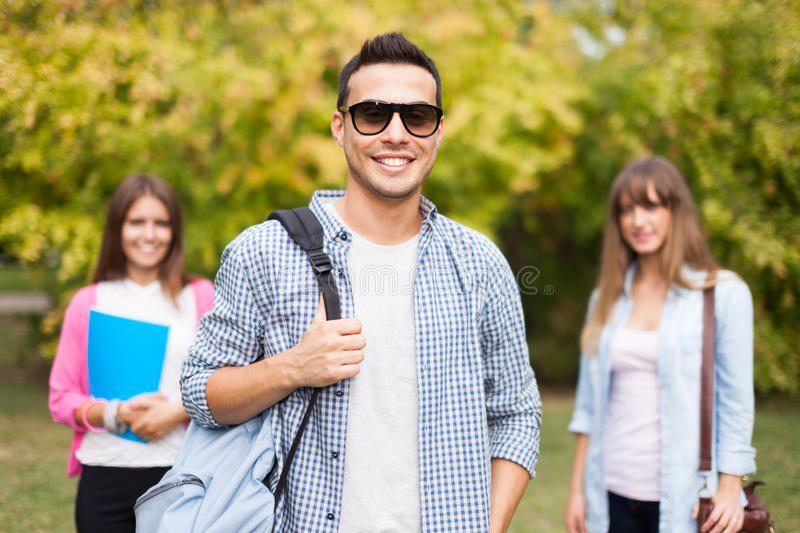 Smiling young man outdoor portrait stock photo