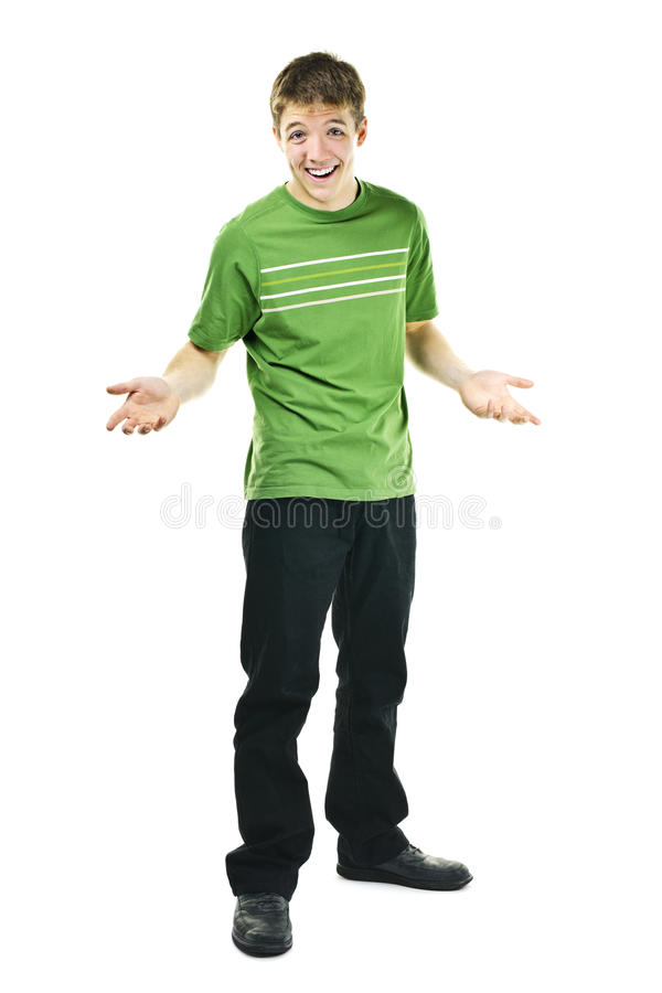 Smiling young man shrugging. Shrugging smiling young man standing isolated on white background royalty free stock photos