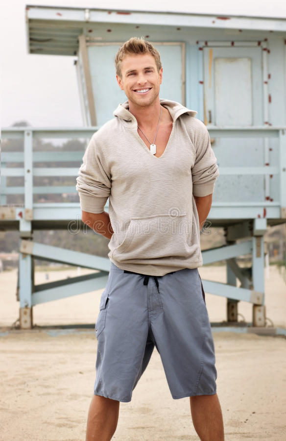 Smiling young man standing royalty free stock photo