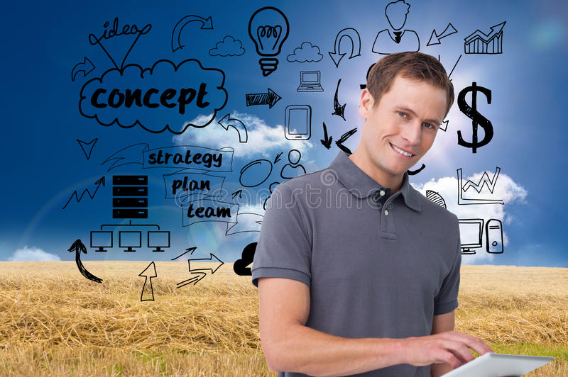 Smiling young man with tablet computer. Composite image of smiling young man with tablet computer royalty free stock photo
