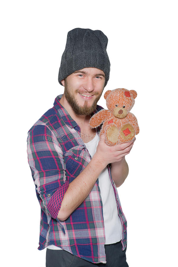 Smiling young man with teddy bear isolated on white background stock photography
