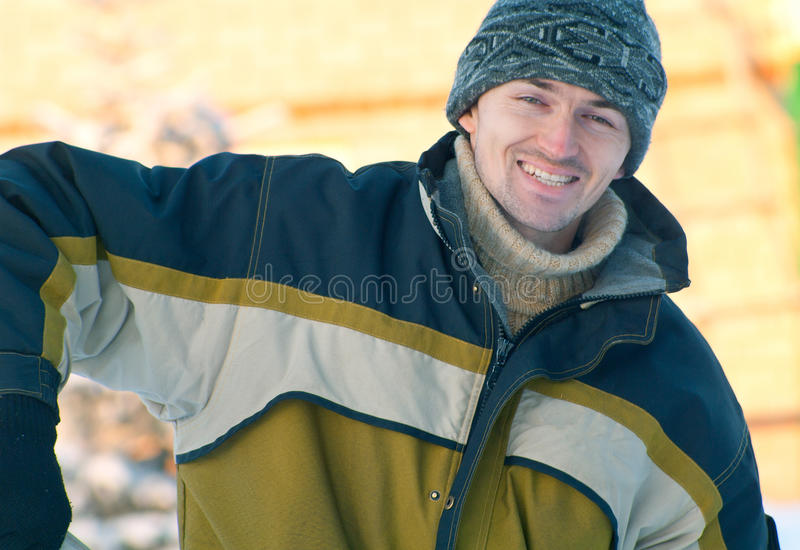 Smiling young men. Portrait of the smiling young men against abstract background. Outdoor royalty free stock photography