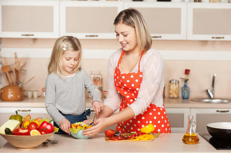 Smiling young mother and her little daughter royalty free stock photography
