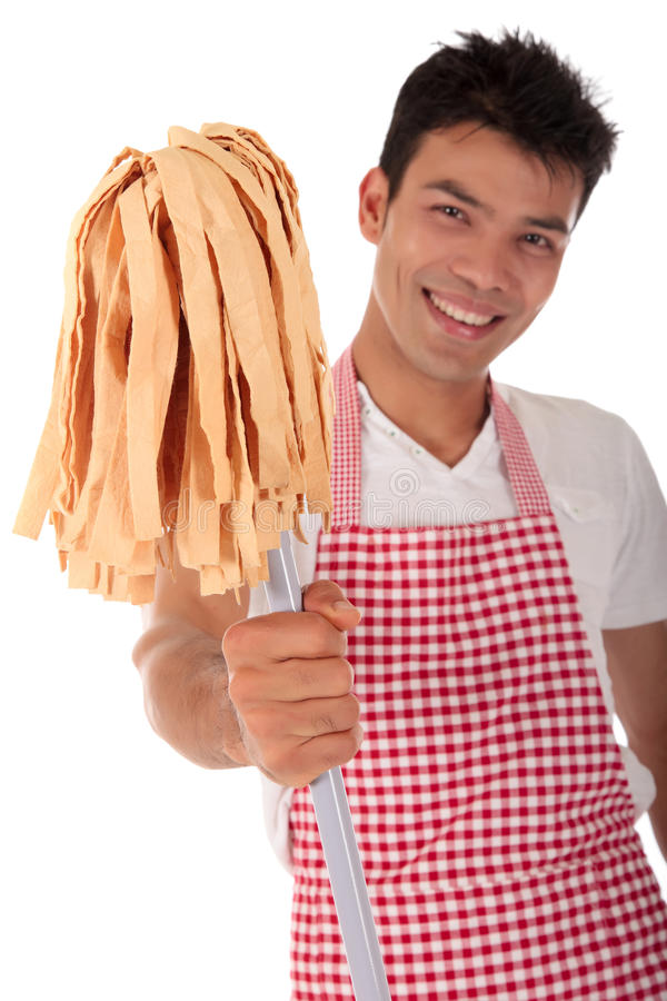 Smiling young Nepalese man, housework stock photos