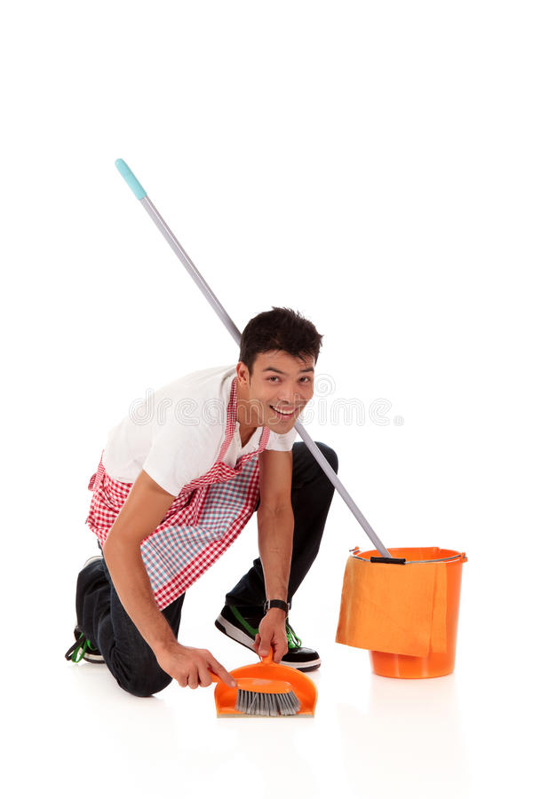 Smiling young Nepalese man, housework royalty free stock images