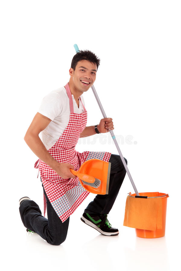 Smiling young Nepalese man, housework stock image