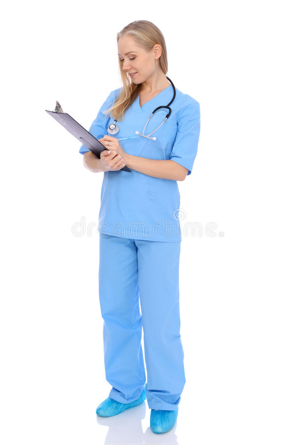 Smiling young nurse portrait isolated over white background. royalty free stock photo
