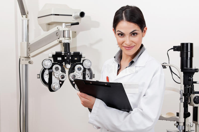 Smiling Young Optometrist With Clipboard stock photography