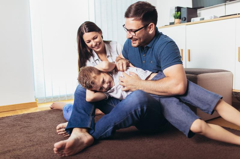 Young parents and their child are very happy, they are at home, selective focus royalty free stock images