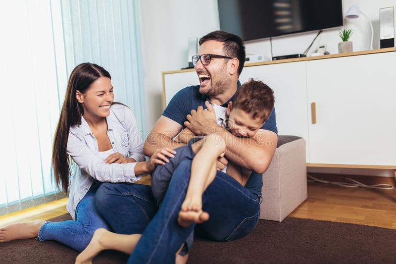 Young parents and their child are very happy, they are at home royalty free stock images