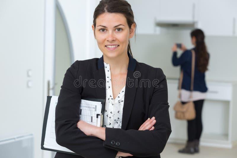 Smiling young realtor looking at camera stock image