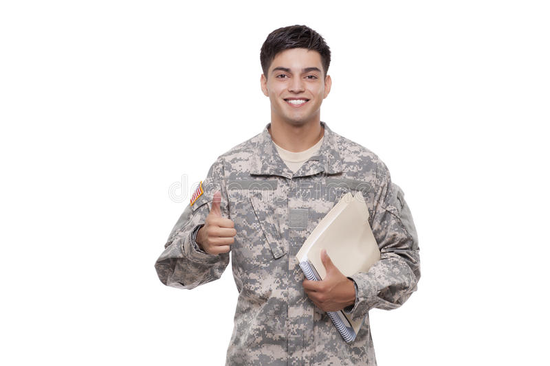 Smiling young soldier with documents gesturing thumbs up