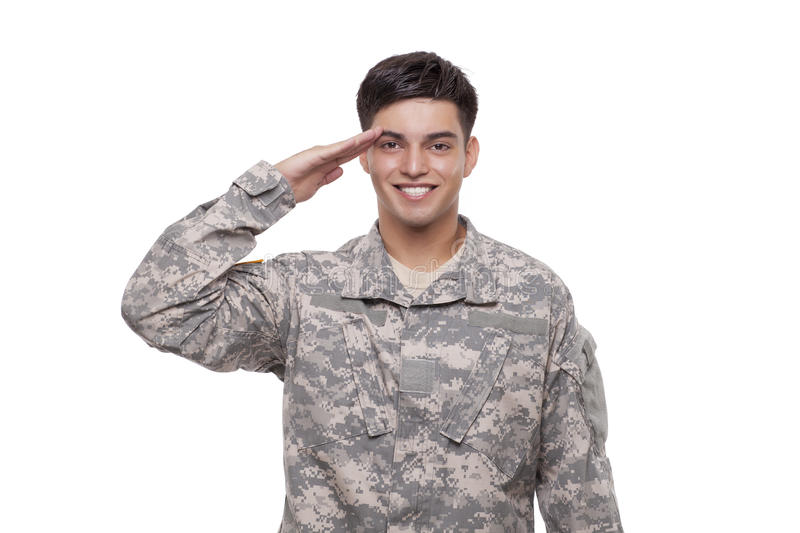 Smiling young soldier saluting royalty free stock images