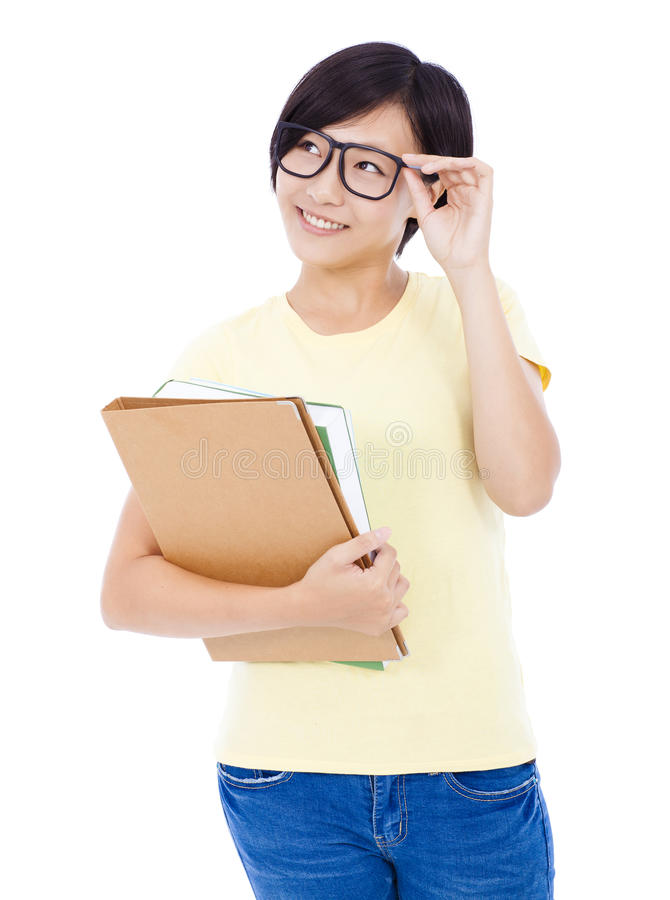 Smiling young student girl standing and holding document stock photo