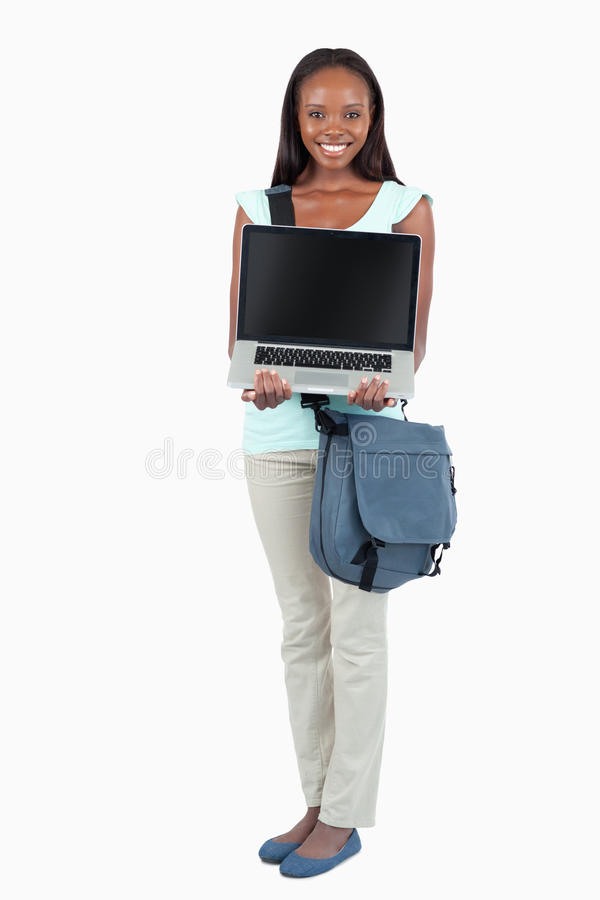 Smiling young student showing her laptop stock images