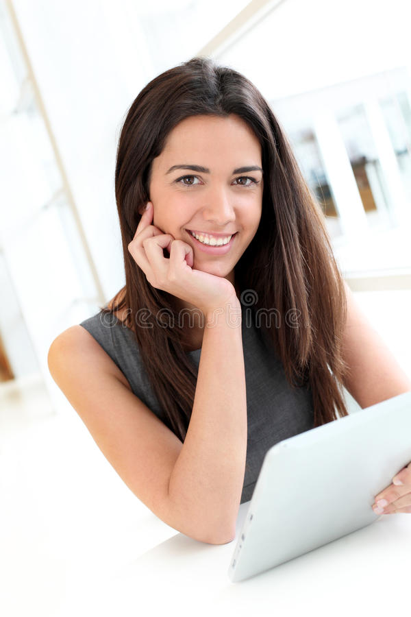 Smiling young student using tablet royalty free stock images