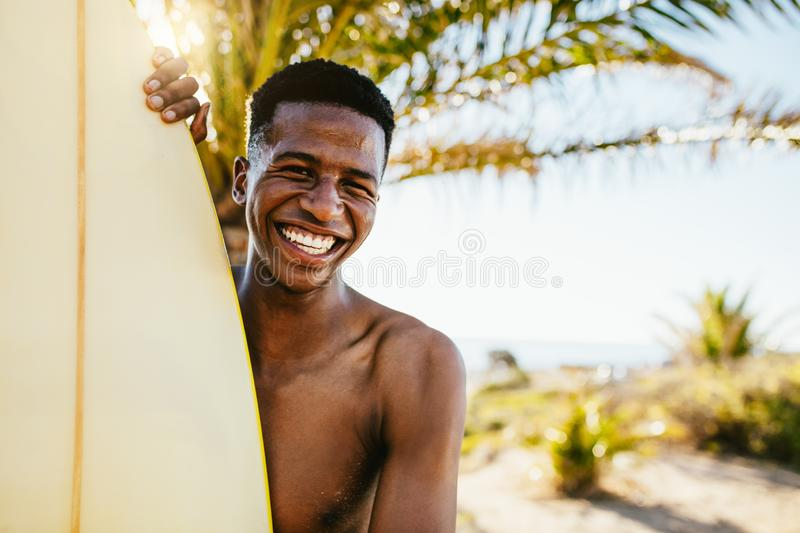 Smiling young surfer royalty free stock images
